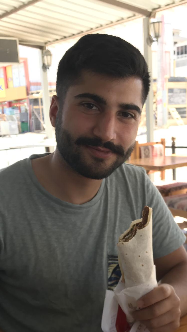 Onur posing with Çiğ Köfte